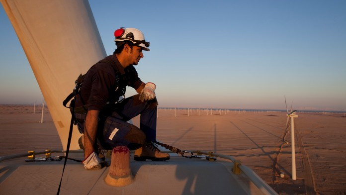 Engineer checking a wind generator in a wind park