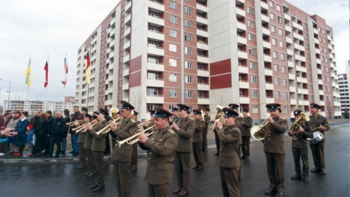 Russian troops march in the city of Novograd