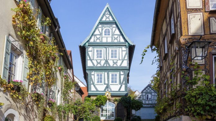 View of a renovated half-timbered house at the end of a street