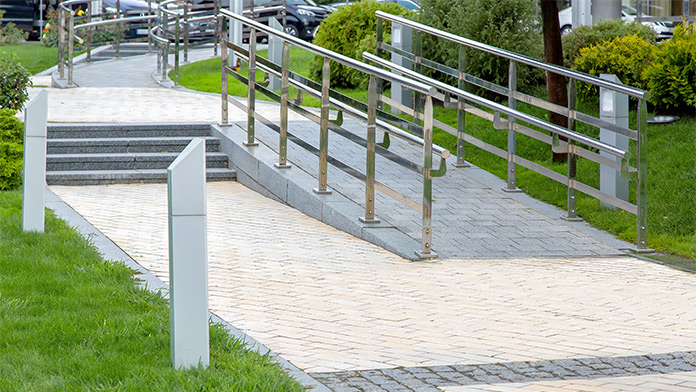Stone ramp with iron railing in a city park for barrier free mobility