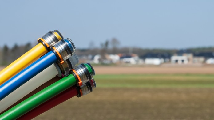 Colored conduits for broadband cable in front of a rural area